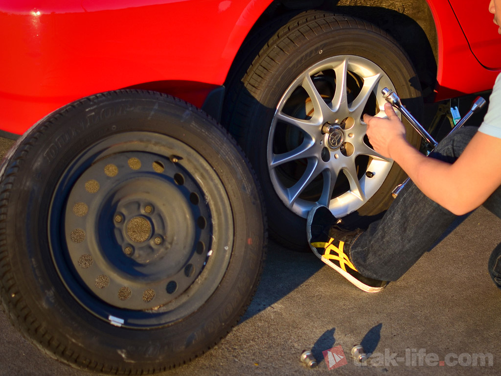 Resting a foot on the tyre will help with removing the nuts