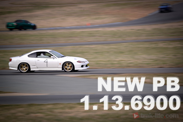 Pearl Nissan 200SX S15 going hard at Wakefield